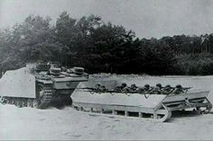 StuG drags a sled of infantry somewhere near Leningrad.