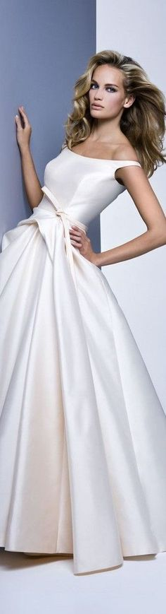 Silk satin wedding dresses with a scoop neckline. Ball gown wedding dresses with a belt at the waist. Designer wedding dresses made of silk satin. Get more bridal gown inspiration at www.dariusfashions.com (custom designs & replicas available)