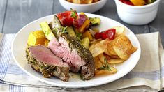 ROAST BEEF FILLET WITH HERBED POTATO CRISPS - Beef and herbed potato crisps make a great family meal for Sunday lunches.