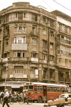 Old building in South Mumbai. BEST bus passing by