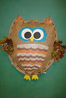 oil pastels, construction paper, craft paper, and shredded paper from the office for filling. Yarn was used to sew the stuffed owl up