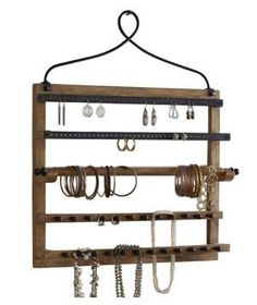 Wall Mount Jewelry Hanger: Not only does this mango wood and iron rack make a decorative statement on a wall, but it keeps earrings, bracelets, and necklaces close at hand.
