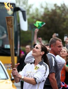 In this handout image provided by LOCOG, Torchbearer #100 Kirsty Gallacher carries the Olympic Flame on day 13 of the London 2012 Olympic Torch Relay between Wigan and Ince-in-Makerfield on May 31, 2012 near Wigan, England. The Olympic Flame is now on day 13 of a 70-day relay involving 8,000 torchbearers covering 8,000 miles.