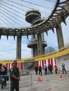 The public was invited inside a New York City architectural monument today for a view that has been off-limits for 27 years. The New York State Pavilion, designed by Philip Johnson, was open for just a few hours this afternoon. Queens Nyc, Roadside Attractions, Montreal Canada, Kew Gardens, Coney Island, World's Fair, Black And White Pictures, Retro Futurism, Modern Man