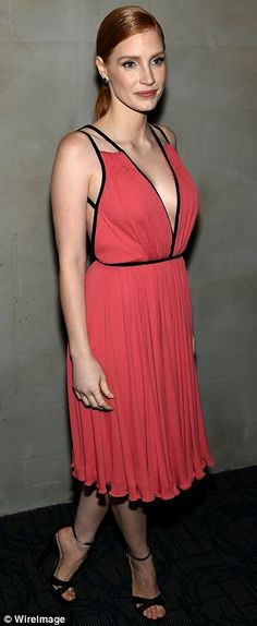 Flashing some flesh: The actress was sexy but elegant in a plunging and backless coral pink Prada dress