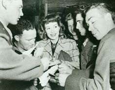 Historic Photograph of Jane Wyman Signs Autographs At The Hollywood Canteen