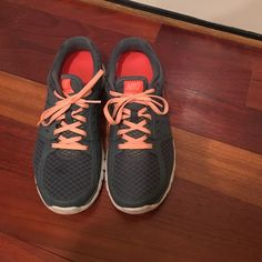 Nike Flex Run Gym Shoes Gray with coral accents Nike running shoes. Perfect condition. Worn handful of times Nike Shoes Athletic Shoes