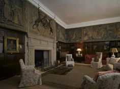The Drawing Room at Hardwick Hall, Derbyshire. The tapestries in this room are thought to have been bought at the same time as the Gideon tapestries in the long gallery from Hatton as Bess again had to add her arms over Hattons. The subject of the tapestries is a mystery. The paneling comes from the old hall. This was Bess' withdrawing chamber.