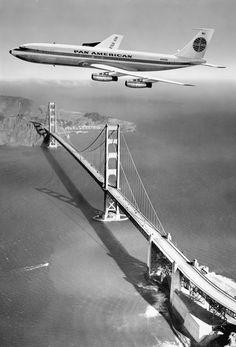 A Boeing 707 flying over the Golden Gate Bridge, 1958.