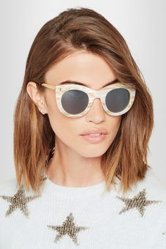 Illesteva's 'Boca II' sunglasses are handcrafted from acetate with a lustrous marble finish. The dark lenses are balanced by a slight cat-eye shape and gold-tone arms, lending a vintage feel to this oversized style. Store them in the designer-stamped case to keep them protected in your tote.