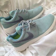 Tiffany Blue Nike Roshe size 8.5 Nike Roshe Tiffany blue with lavender accents. Woman's size 8.5. No box but they are brand new, never worn. NO TRADES OR HOLDS! Use the offer button to negotiate, I won't respond to comments about price.   ••if you have a problem with my price then shop another closet. Posh takes a 20% fee plus these shoes have been sold out over a year and retail more than I'm charging. Don't be rude•• Nike Shoes Sneakers