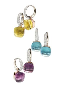 Pomellato's Nudo earring collection is stunning. Available in a plethora of different stones at Oster Jewelers. 18k Rose & White Gold Nudo Earrings shown: - Blue Topaz - Amethyst - Lemon Quartz
