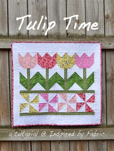 Tulips and Pinwheels Remind Us of Spring! You'll love displaying this cheerful quilt year after year. It's a charming reminder that spring is on its way. It's sure to make you smile whenever you see it. It's also an easy and highly adaptable project. Add more blocks, rows or borders to make a larger quilt. …Tulip Time Quilt Tutorial