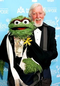 Carol Spinney and his pal Oscar. I can't believe that Oscar was convinced to wear a (albeit wilting) flower on his tuxedo!