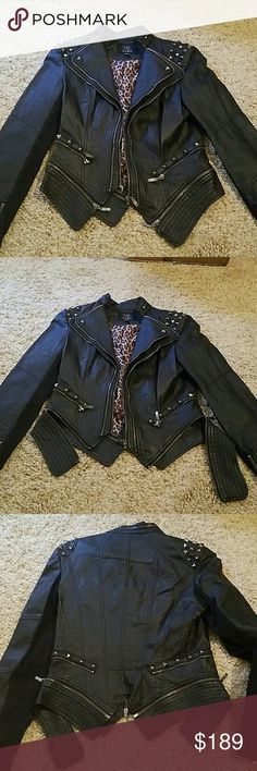 Faux leather studded short zipper jacket Very sexy studded jacket with removable bottom part V shape in the back. Studs on shoulders wrist over pockets. Look at last picture missing one student but not noticeable tcec Jackets & Coats