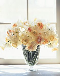 Here, daffodils are arranged in a simple vase, which showcases the beauty of the flowers with their different-hued centers. Daffodils release a substance harmful to other flowers, so they are best kept to themselves in arrangements.