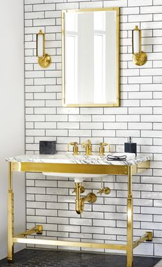 Brass and white bathroom design paired with white subway tile from our Grove Brickworks collection (paired with dark grout). A white marble counter sits atop our R.W. Atlas Washstand in brass, paired with the perfect brass bath faucet and brass bath accessories.    R.W. Atlas Washstand and Faucet Waterworks Bathroom, Brass Bathroom Faucets, Bathroom Cabinetry, White Bathroom Tiles, Bathroom Paint Colors, White Bathrooms, Bath Design, Tile Design, Upstairs Bathrooms