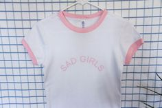 Rare sad girls ringer tees in baby pink and white! The shirt is fitted, short sleeve, and made out of 100% cotton. For more tumblr aesthetic
