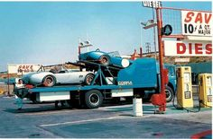 """March 1966: A Shelby American transport truck delivers two brand new 427 Comp Cobras to the Carroll Shelby School of High Performance Driving at Willow Springs. Ken Miles was to test drive every Comp Cobra before delivery. The Blue Cobra is CSX3018 and was being delivered to the school for its new owner, """"student"""" Richard Messersmith."""