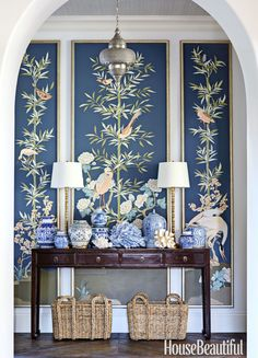 """I like making a statement in an entry,"" says designer Summer Thornton, who commissioned custom panels and massed blue-and-white porcelain for a Florida home's foyer."