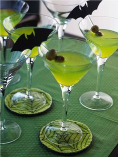 Green Bat-inis:  1 cup fresh squeezed lemon juice ¼ to ½ cup sugar ½ cup fresh mint leaves 1 cup sparkling mineral water Dash ginger ale 2 to 3 cups ice 1 cup vodka Frozen vodka Mint sprigs and lemon slices for garnish For the full recipe and more #Halloween creepy #cocktails visit: http://blog.gifts.com/holidays/spook-tacular-halloween-cocktails