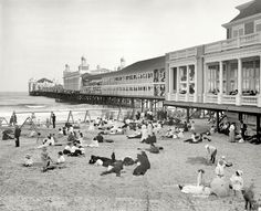 """I can't believe they had to wear suits to the beach.  Plus, what is that dark circle in that wave out there? Click on the pic to blow it up. The Jersey shore circa 1904. """"Steel Pier, Atlantic City."""""""