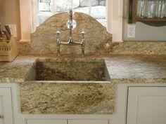 granite sink with broken pediment backsplash