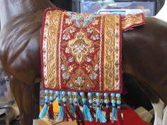 Well, got the tassels on the drape(not the butt drape yet)...........Notice something missing???