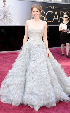 Amy Adams, Oscars 2013 -- The talented actress stunned in a frothy Oscar de la Renta gown in powder blue. The strapless sweetheart neckline looked dreamy and elegant; the full-skirted silhouette exuded a fairytale-like quality fit for a princess. Diamond drop earrings and a sparkling cuff bracelet completed her lovely look.