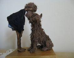 Fetch boy with dog sculpture. Made to door Stephaniessculptures