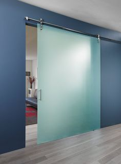 Our sister company spaceplus.com provides stunning interior glass solutions for commercial projects, like this  sleek sliding glass barn door in an #office waiting room.