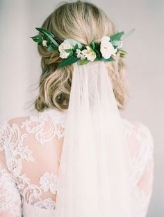 medium wedding hairstyle with flower crown and veil #wedding #weddinghairstyles #bridalfashion