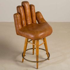 Set of Three Leather Baseball Glove Swivel Bar Stools, Signed | From a unique collection of antique and modern chairs at https://www.1stdibs.com/furniture/seating/chairs/