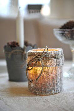 So cute. An old wooly sock, cut up and put around a glass with a candle!