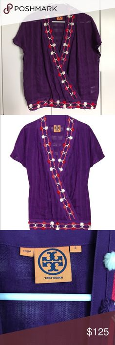 Tory Burch Imperial Purple Linen Embroidery Top This purple linen embroidery top from Tory Burch has never been worn! The Imogen Top, in deep purple, channels a pretty, free-spirit attitude. It works well layered or on its own for a sexy, bohemian flare. Windowpane knitted linen. Bead and multicolored pompom detail, silk-trimmed crossover front, silk-trim elasticated waistband. Snap fastening at front. 100% linen; trim: 100% silk. Dry clean. Loosely fitted design. Semi-sheer style. Tory…