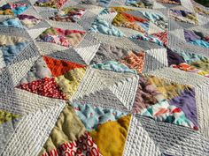 quilt from Winding Bobbins - interesting to quilt the neutral areas and leave the printed areas unquilted