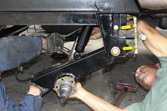 Install the supplied shock absorbers prior to bolting the rear of the axle assembly to the center spring hanger.