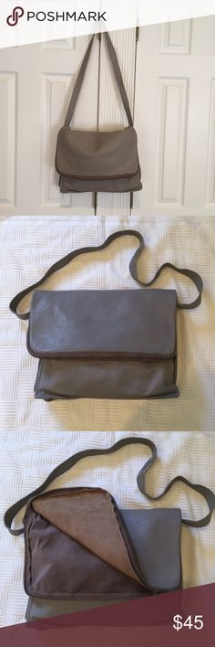 ITALIAN LEATHER HANDBAG HANDBAG MADE IN ITALY FOR BONWIT TELLER.   BEAUTIFUL GRAY LEATHER BAG.  The strap is long enough to wear as a CROSSBODY.    The front flap zippers around for storage. The front and inside has a zipper pocket. The inside has a separation. The LEATHER is soft but sturdy and is in great condition except for a discoloration and slight wear in the corner shown in the last picture.  The INSIDE has normal wear and no rips or tears. BONWIT TELLER Bags Crossbody Bags