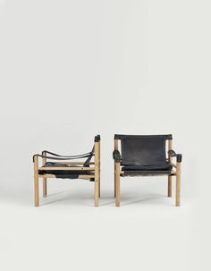 A pair of Arne Norell safari sirocco chairs, beech and black leather, Sweden, 1960s