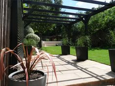 A funky black pergola creates a unique backdrop for climbing plants...  http://www.jacksons-fencing.co.uk/News/customer-projects/funky-black-pergola-2920.aspx?agid=597 #garden #design #pergola #structure #home