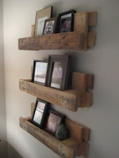 Picture ledges made from pallets.  Awesome up-cycling.