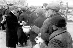 Warsaw, Poland, Jews, holding pots, queueing for food, May 1941.