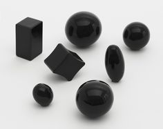 """Fiona Banner refers to her Table Stops as """"abstract points of focus."""" Sleek black objects reminiscent of paperweights on an executive's desk, these forms are based on punctuation marks (periods, or full stops) as they appear in a range of fonts: Klang, Slipstream, Avant-Garde, Nuptial, Formata, Optical, and Courier."""