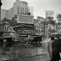 "March 1943. ""New York, N.Y. Times Square on a rainy day."" Now playing: Disney's ""Saludos Amigos."" Afterward we can grab a bite at the Automat."
