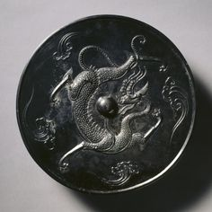Cleveland Museum of Art Mirror with a Coiling Dragon, China, Tang dynasty bronze, Diameter - cm inches) Wt: 329 g Overall - cm inches) Rim - cm inches). Thomas and Martha Carter in Honor of Sherman E. Stone Age Art, China Art, China China, Bronze Mirror, Cleveland Museum Of Art, Chinese Dragon, Chinese Antiques, Vintage Ornaments, Archaeology