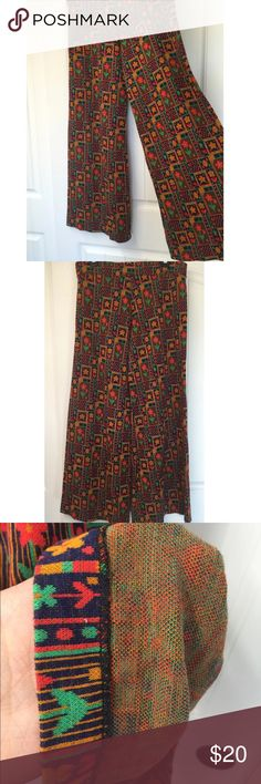 """Palazzo Pants Double Knit Poly Wide Bell 70s vtg Vtg Palazzo Pants Double Knit Poly Floral Hippie Boho Wide Leg Bell 1970s  Flower power! Amazing vintage double knit poly palazzo pants.  Navy, red, Green and golden yellow colors.  Warm double knit poly, great for fall! No size tag, tag inside says """"machine washable, drip dry"""".  Measured laying flat unstretched, please check measurements to ensure proper fit.  Waist: 16.5"""" Hips 19"""" Inseam 30.5' Rise 10"""" Overall length 39"""" Leg opening: 14""""…"""