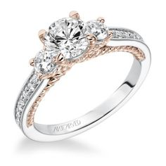 Love this three stone engagement ring with unique rose gold details on the band!