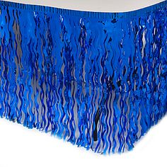 The royal blue wavy table skirts aren't your average table skirt. Each Royal Blue Wavy Metallic Table Skirt features metallic royal blue streamers cut in a wavy pattern. Sweet 16 Decorations, Diy Birthday Decorations, Tulle Table, Bubble Guppies Party, Quinceanera Themes, Royal Blue And Gold, Boy Baby Shower Themes, Metallic Blue, Metallica
