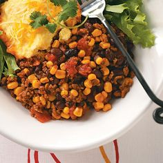 Slow Cooker Tamale Pie Recipe -Canned beans and corn bread/muffin mix speed up the prep on this crowd-pleasing main dish that's perfect for busy evenings and carry-in dinners. —Jill Pokrivka, York, Pennsylvania