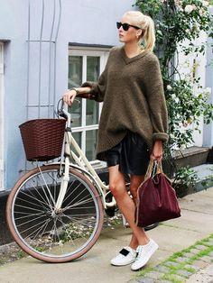 On Ellen Claesson of Ellen Claesson: Acne Studios sweater and Adriana Stripe Sneakers ($222) in White/Black; Gestuz Marilee Shorts ($109); Stella McCartney Falabella Small Fold-Over Tote ($1195)...